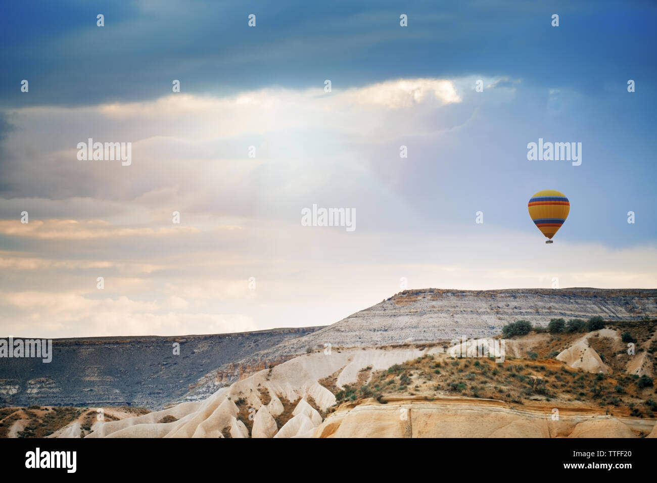 Hot air balloon flying over the rocks - Stock Image