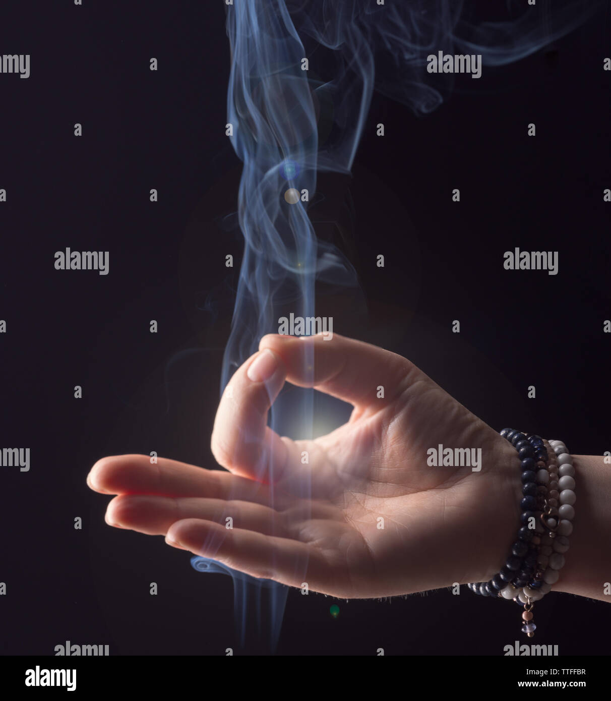 Hand woman enlightened while meditating Stock Photo