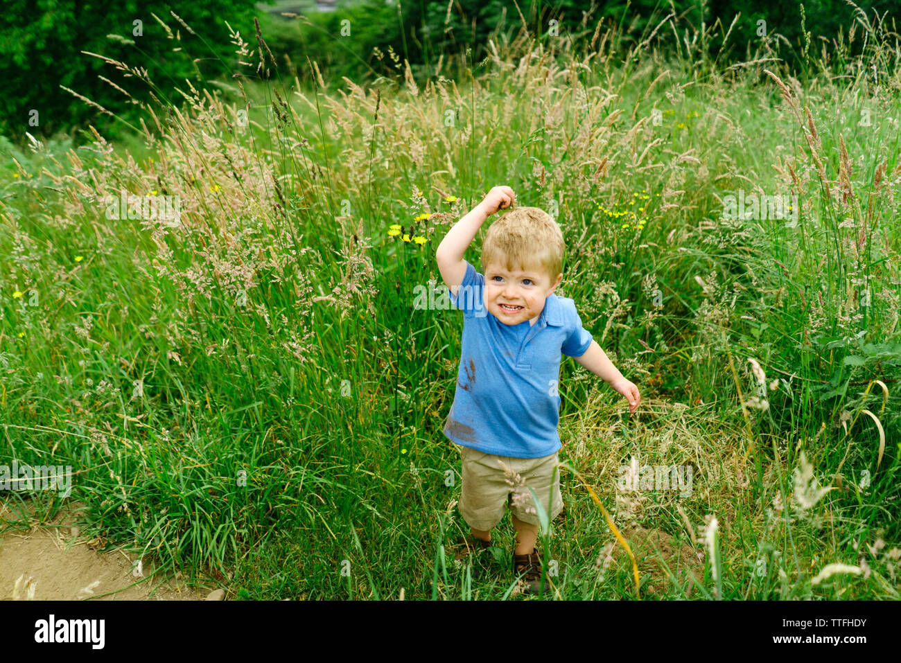 View from above of a young boy playing in the dirt - Stock Image