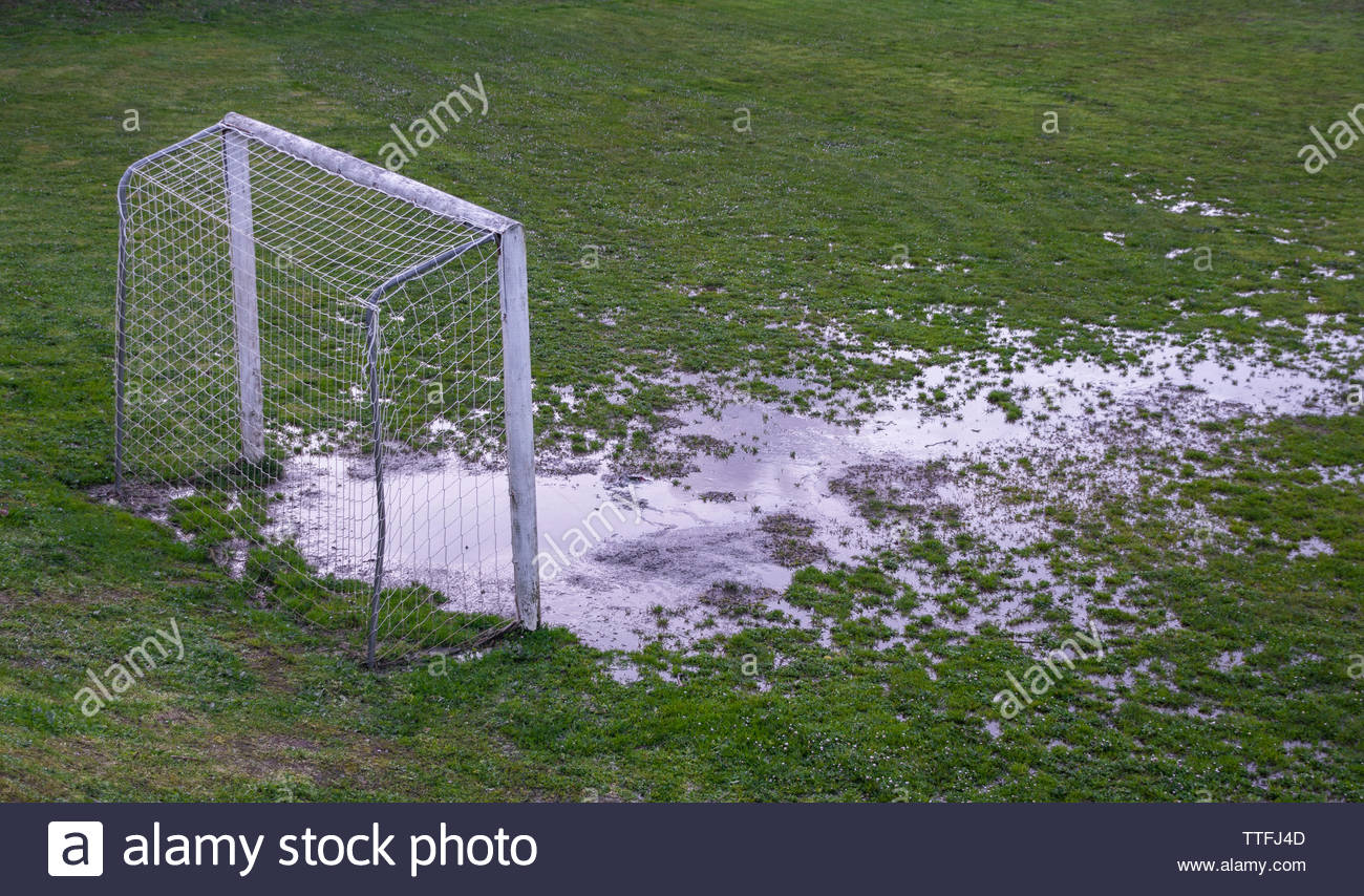 Waterlogged soccer field with goal post Stock Photo