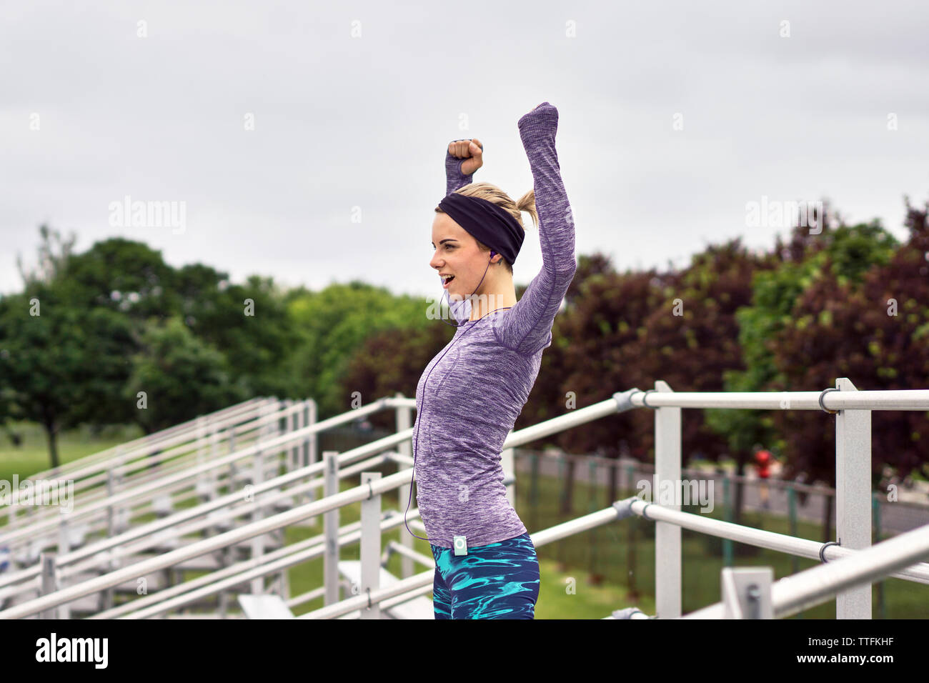 Motivated female with arms out with successful attitude Stock Photo