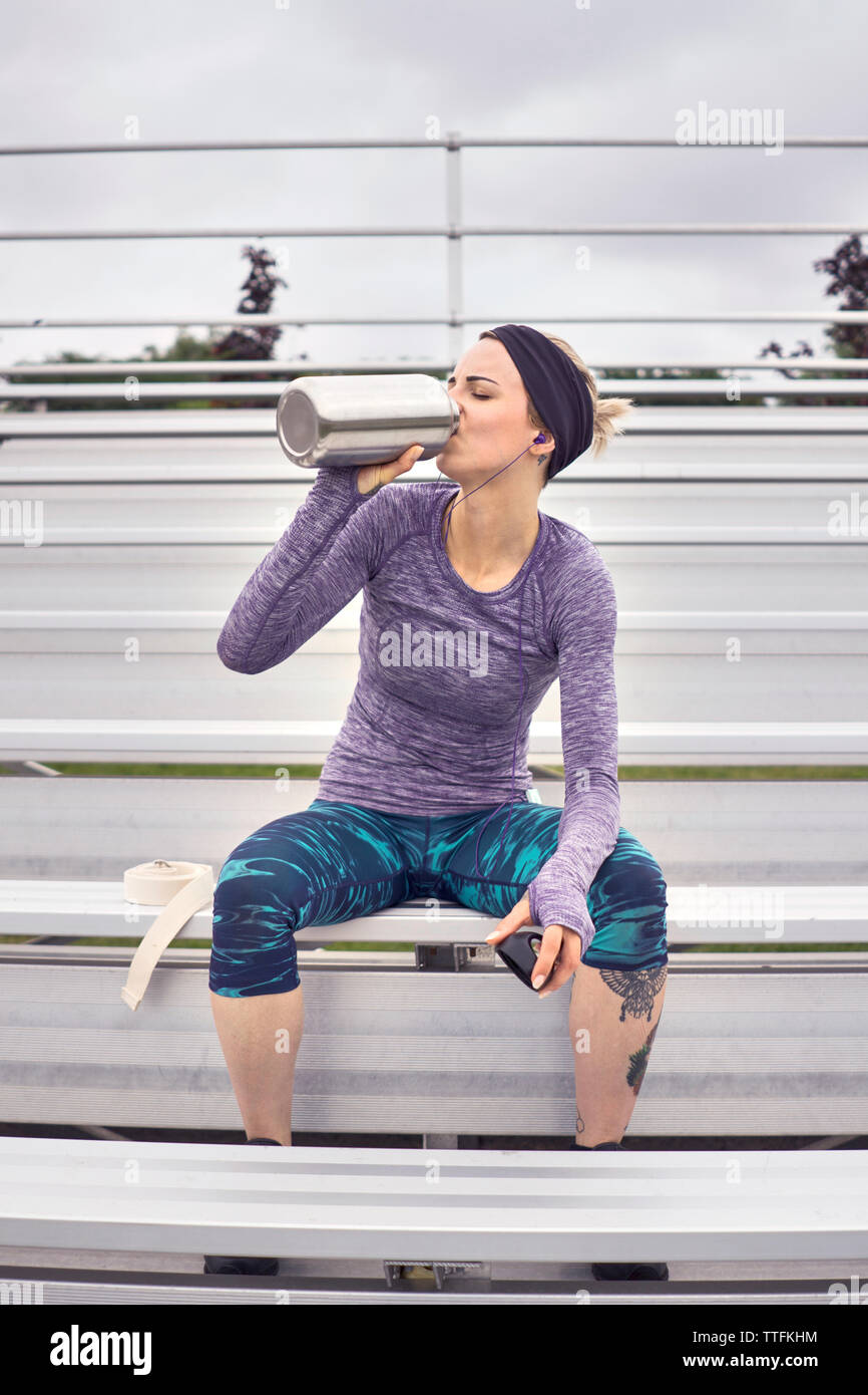 Female working out and drinking water Stock Photo