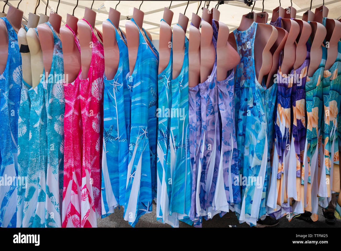 Sundresses on sale at a festival in Owego, New York, USA. - Stock Image