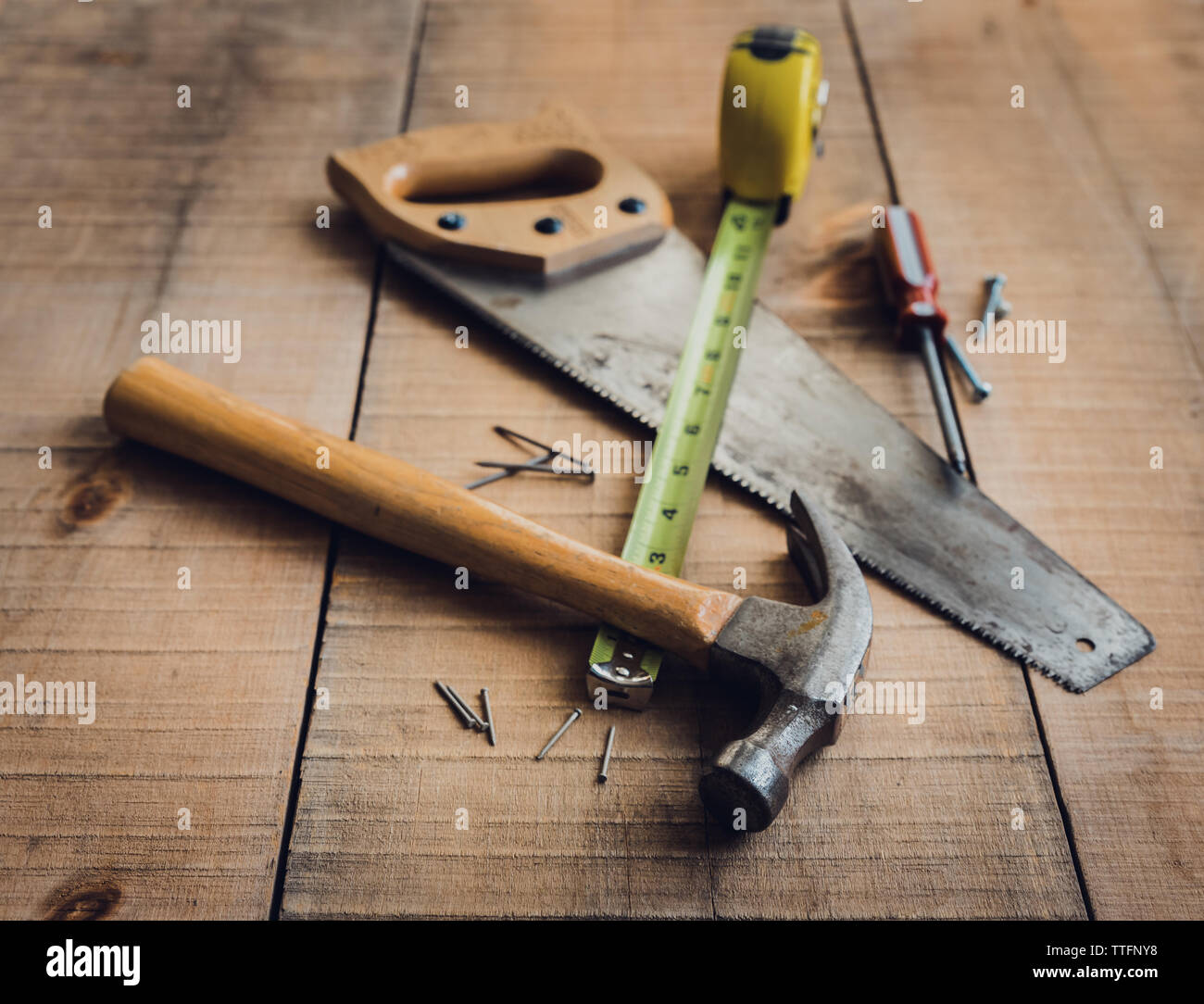 Woodworking tools scattered on a wooden table. - Stock Image