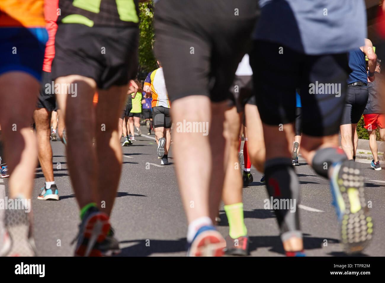 Marathon runners on the street. Healthy lifestyle. Athletes endurance - Stock Image