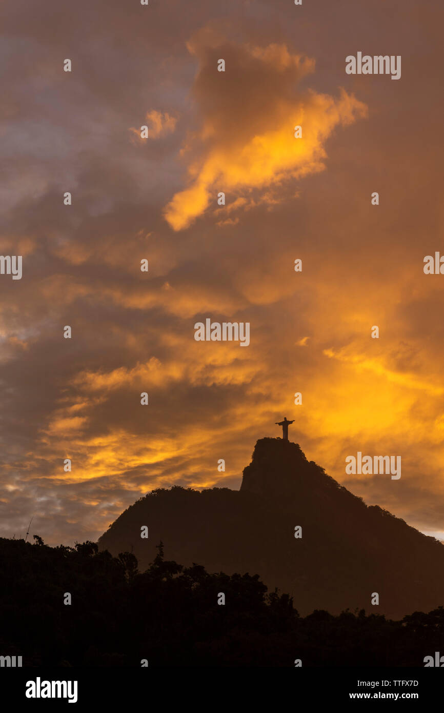 Beautiful sunset landscape with orange clouds over Christ the Redeemer Stock Photo
