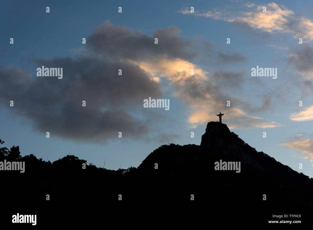 Beautiful landscape of Christ the Redeemer statue during sunset time Stock Photo