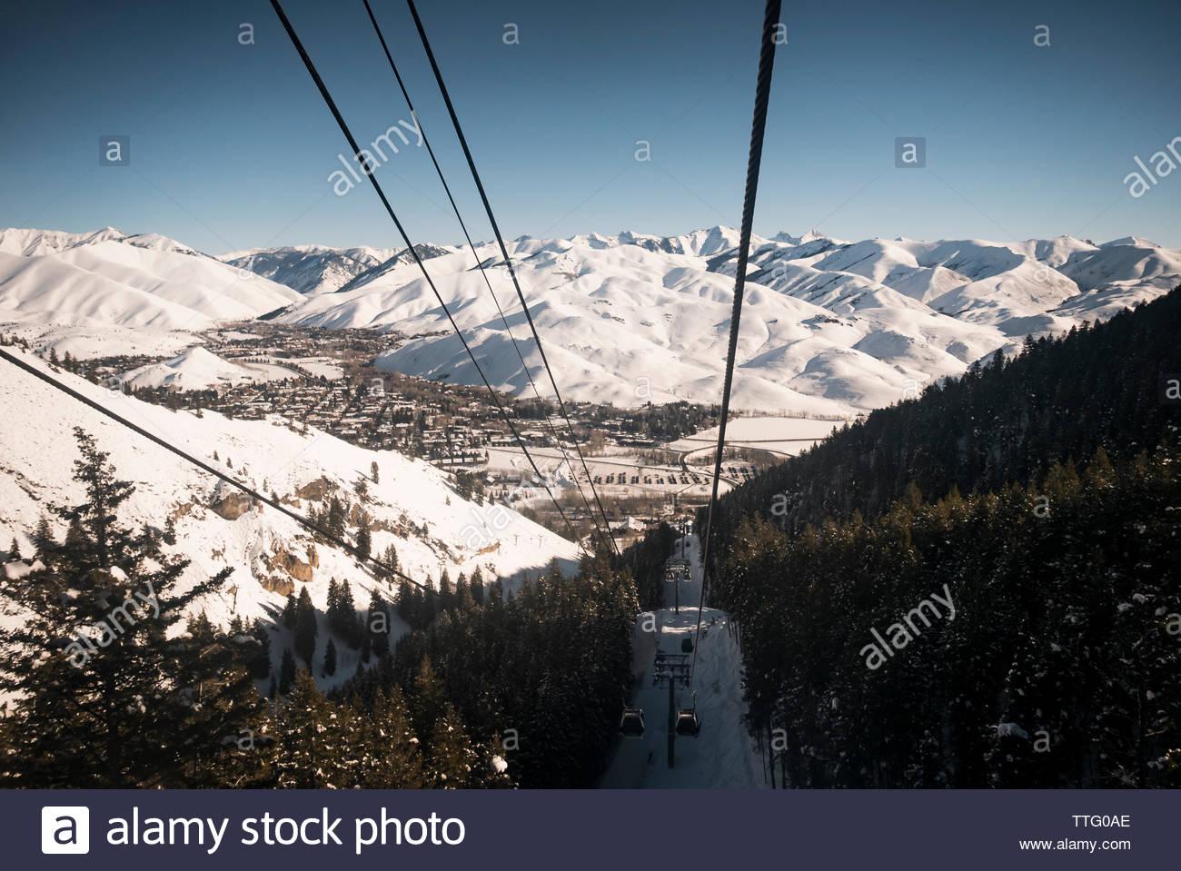Headed up the gondola on a sunny blue bird day in Sun Valley, Idaho. - Stock Image