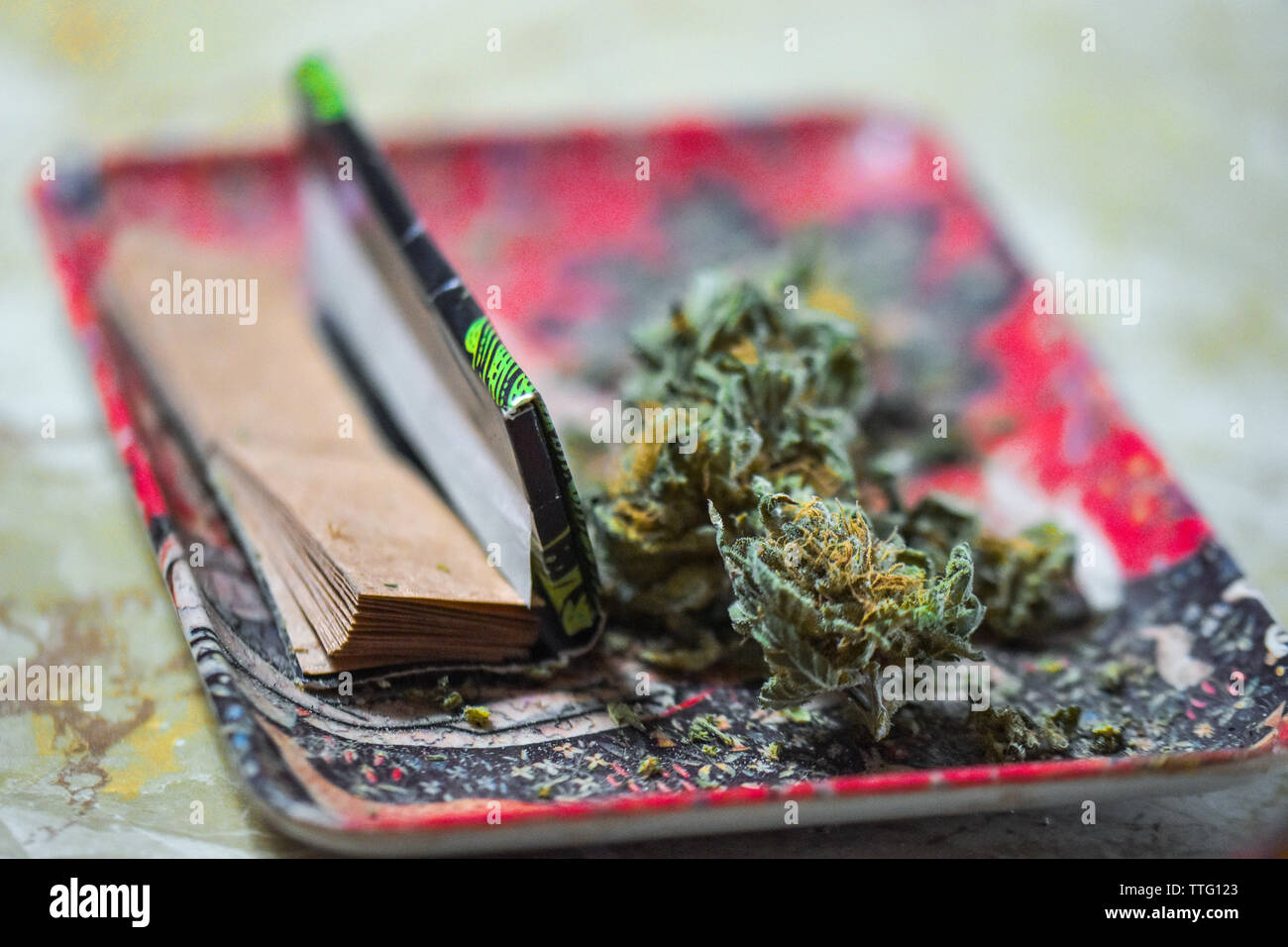 Marijuana on Tray with Cigarette Papers - Stock Image