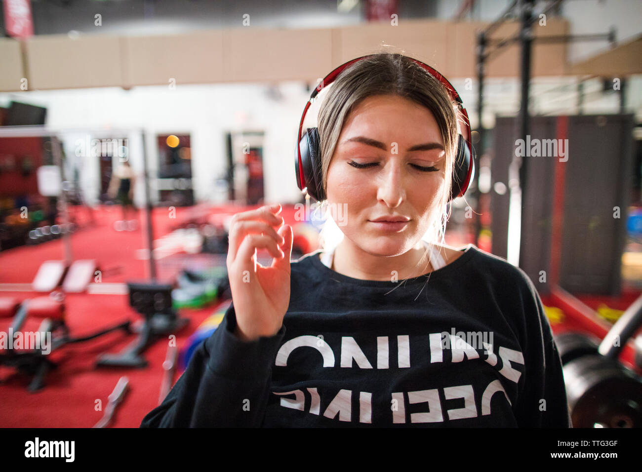 Attractive woman listening to music during a workout at the gym. Stock Photo