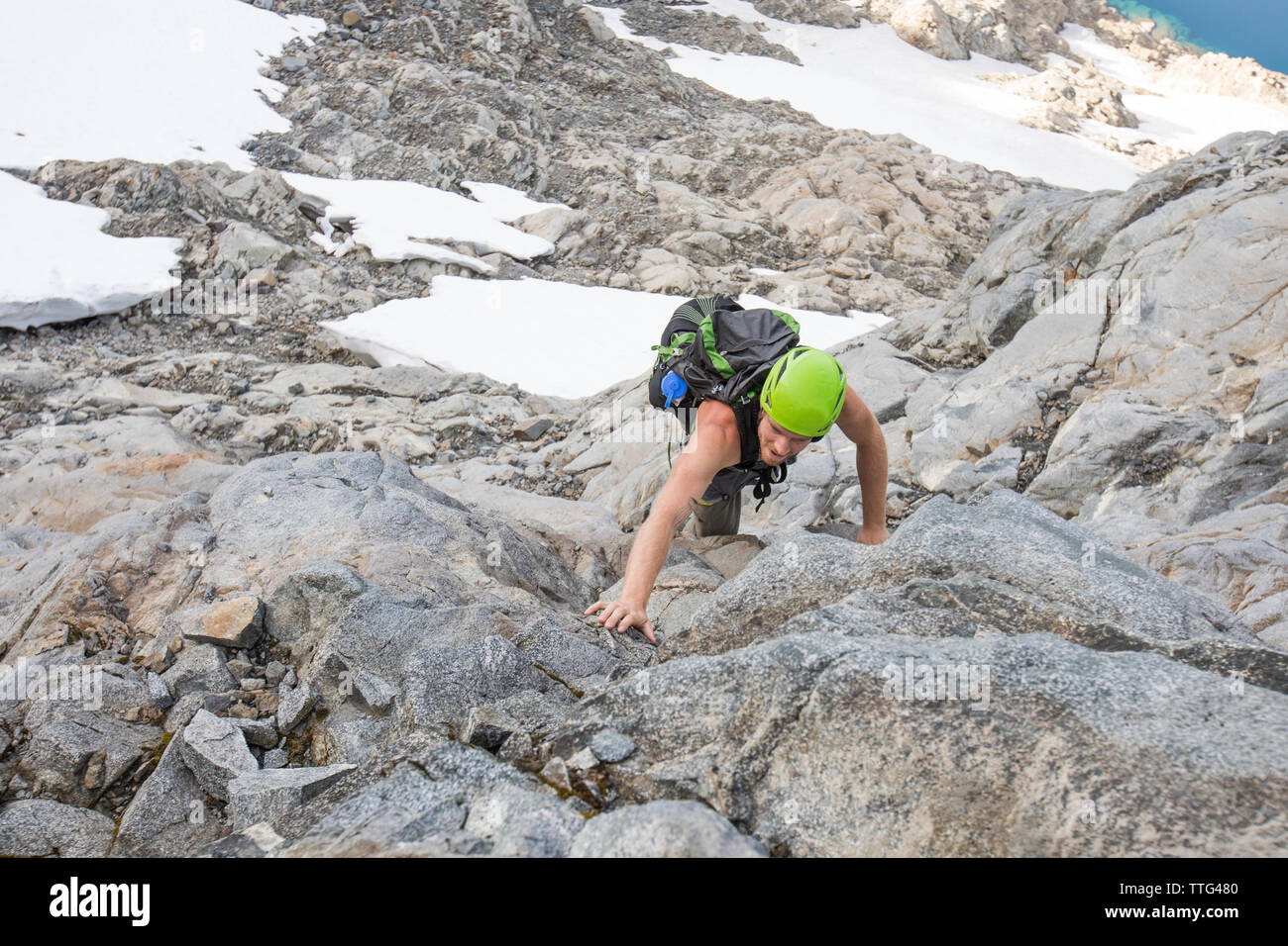 Climber ascends a low angle route on Douglas Peak, British Columbia. - Stock Image
