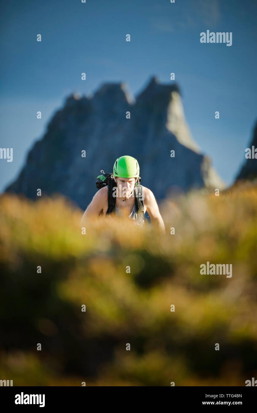 Climber approaches some easier terrain, Douglas Peak, B.C. - Stock Image