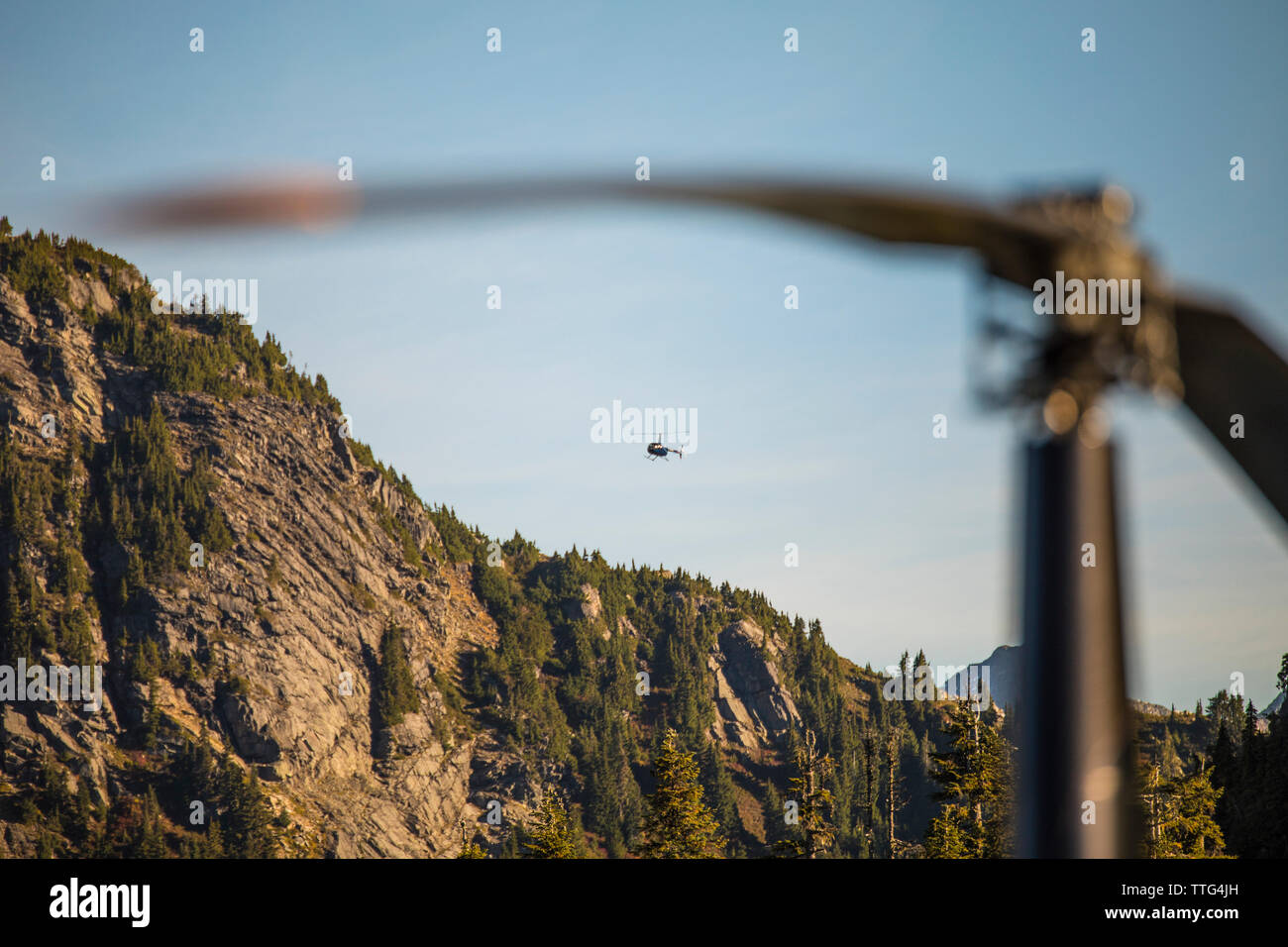Helicopter flying over the Coast Mountain Range. Stock Photo