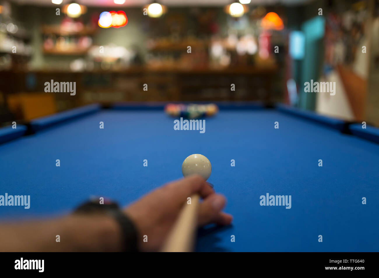 Cropped image of hand playing pool - Stock Image