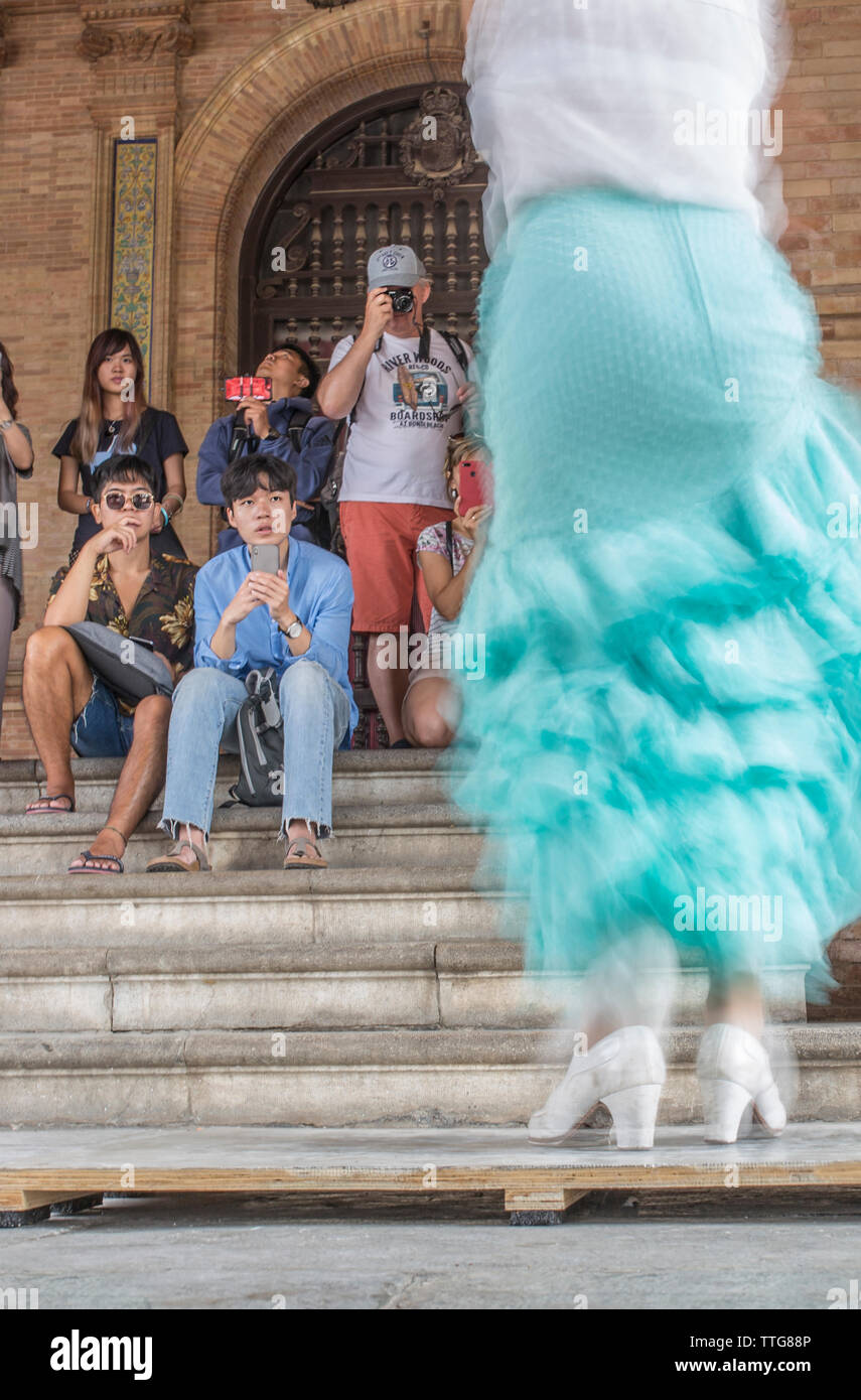 Flamenco dancer performing and Japanese tourists - Stock Image