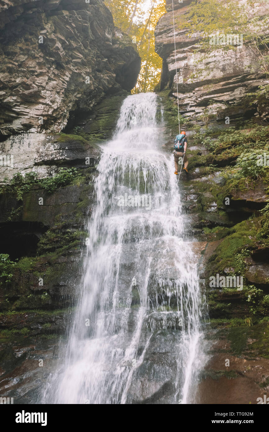 Man rappels waterfall in the Catskills, New York - Stock Image