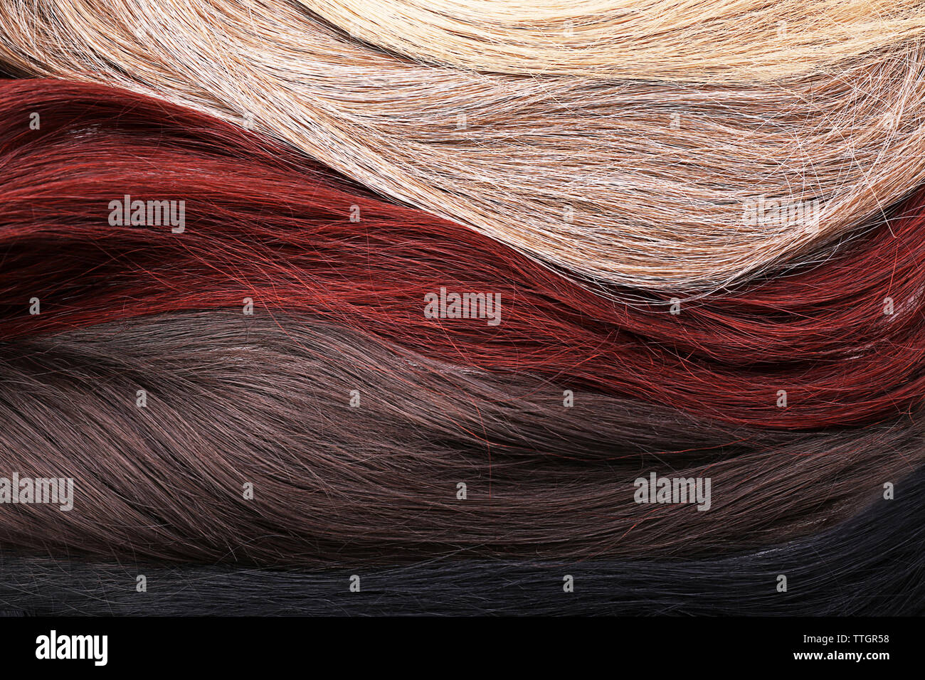 Varicolored strands of hair, close up - Stock Image