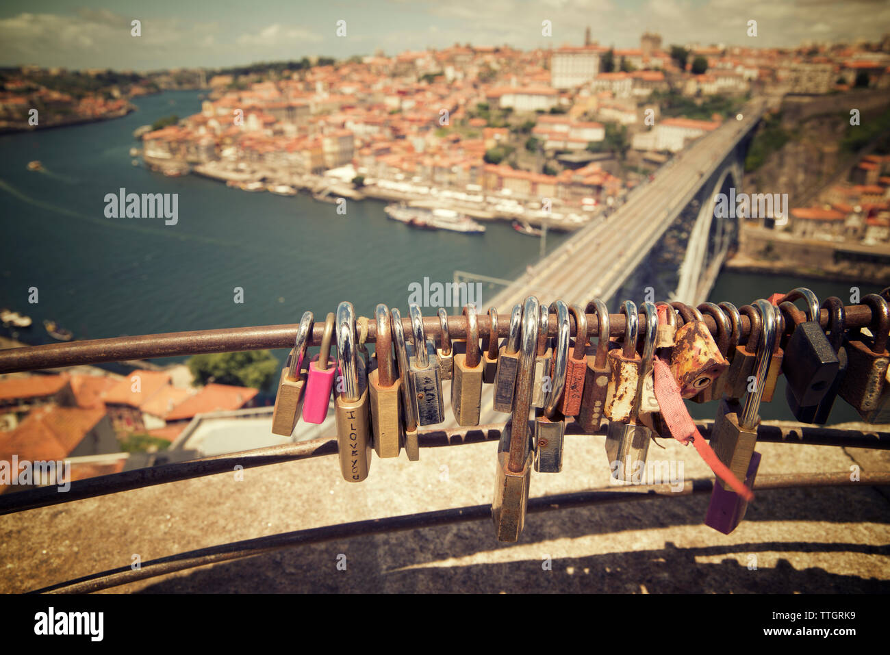 High angle view of padlocks on railing against cityscape Stock Photo
