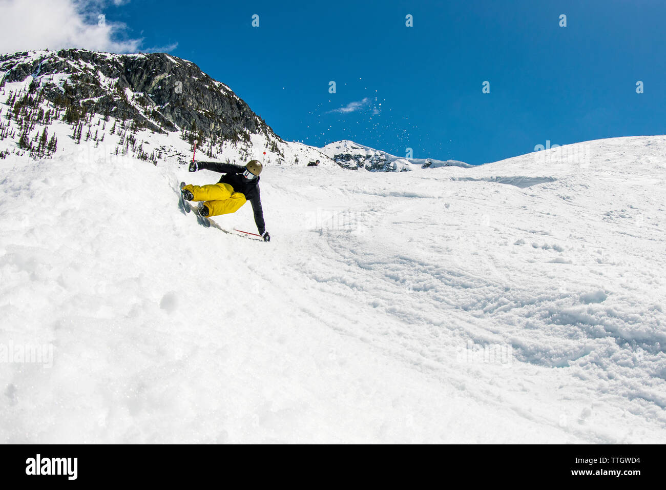 A man skis a banked course in the terrain park at Whistler Blackcomb. Stock Photo