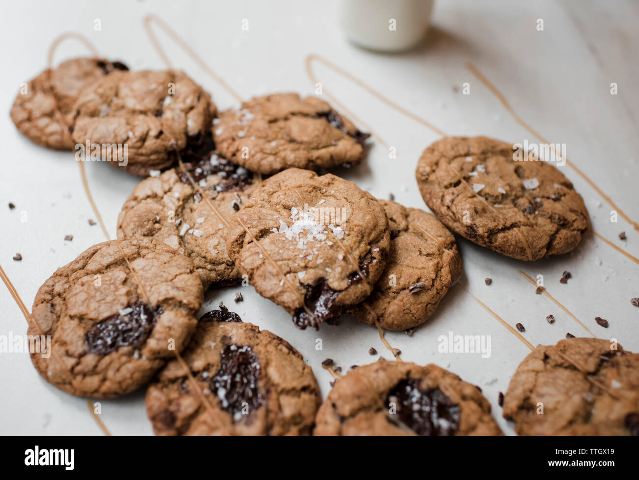 homemade chocolate cookies covered in caramel with milk - Stock Image