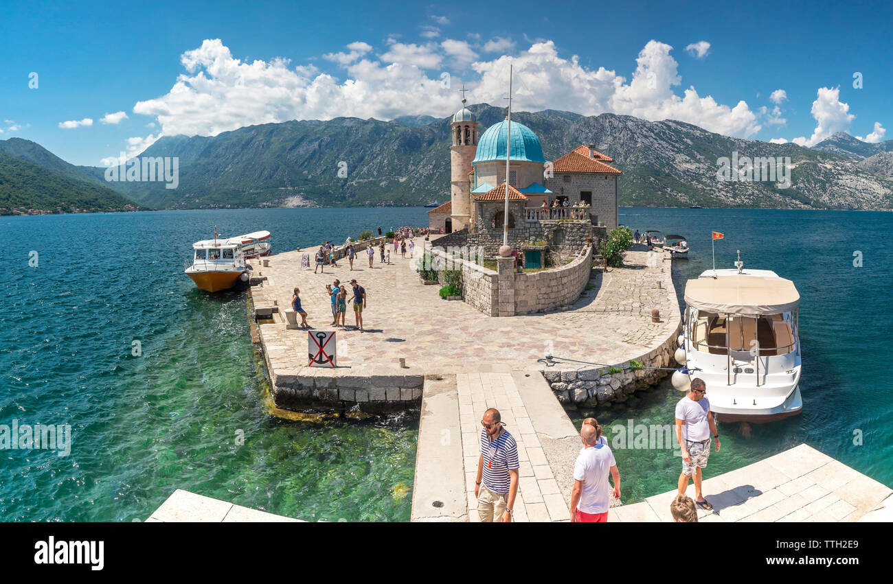Perast, Montenegro - 07.11.2018.  Our Lady of the Rocks church on an Island in the Bay of Kotor, Montenegro,  in a sunny summer day - Stock Image