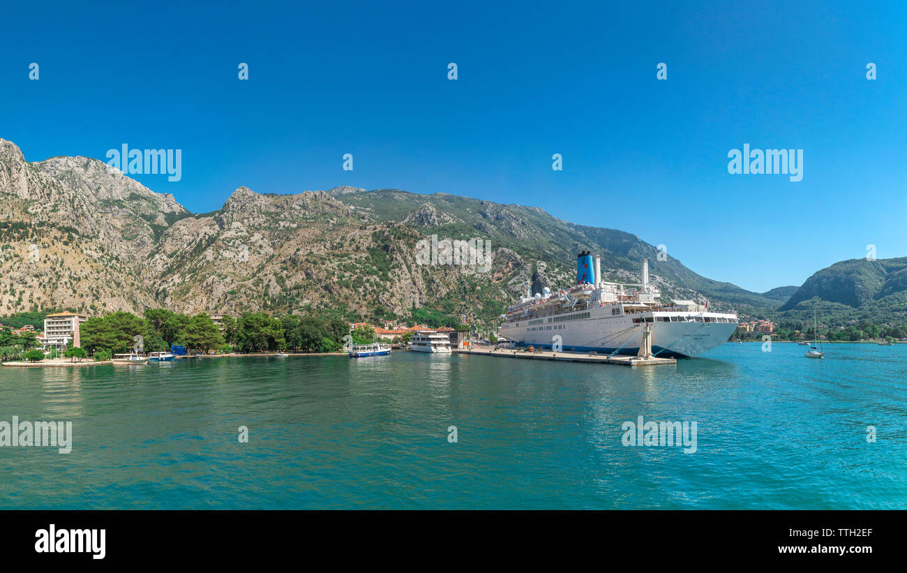 Kotor, Montenegro - 07.11.2018.  View from the sea to the cruise liner at the pier of the old town of Kotor and fortification wall around the city in - Stock Image