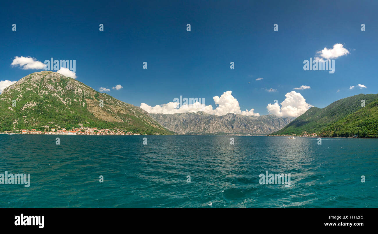 Panoramic view from the sea to the Kamenari-Lepetane Ferry crossing in the Bay of Kotor, Montenegro, in a sunny summer day. - Stock Image