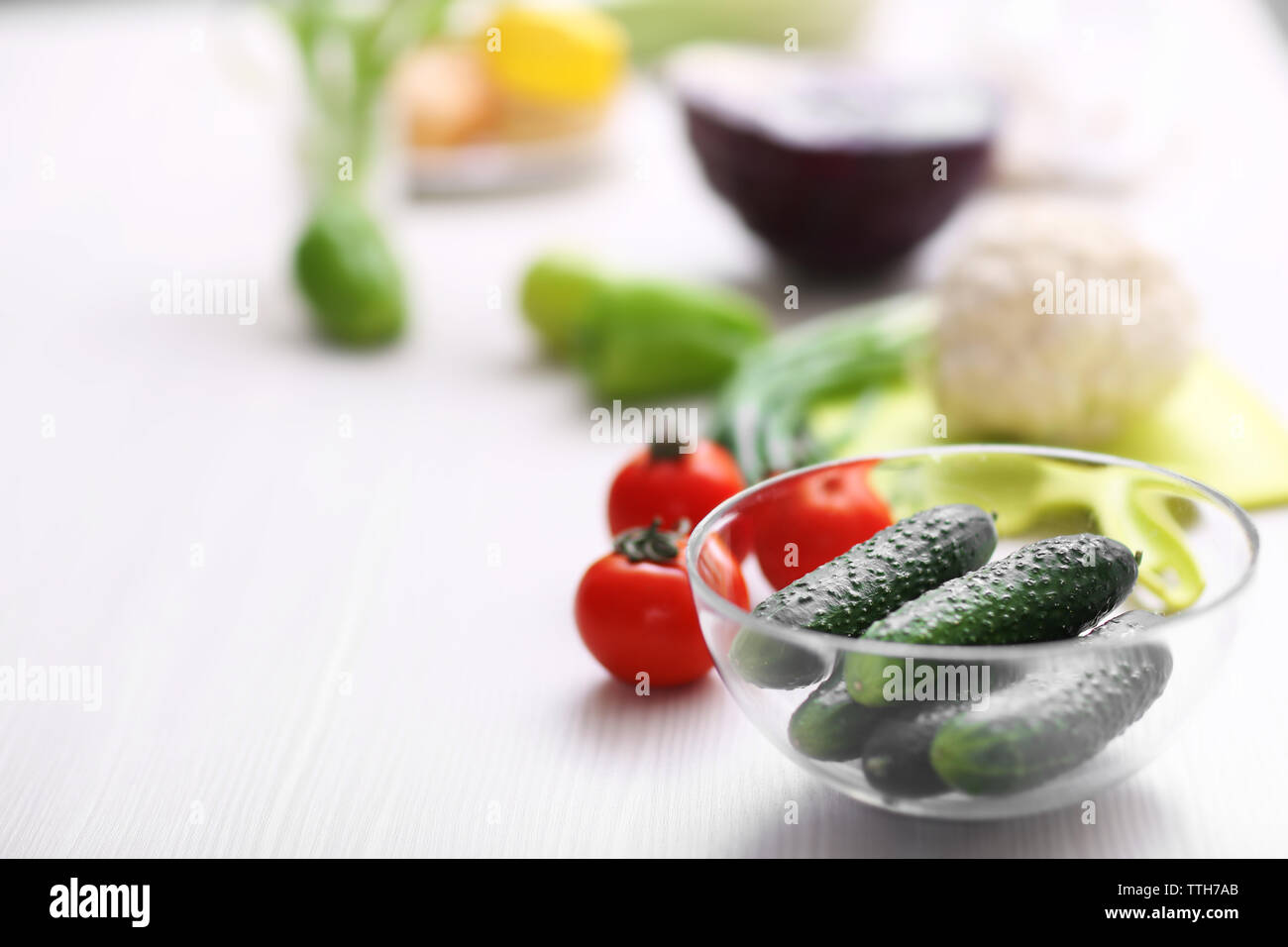 Fresh vegetables on a kitchen table - Stock Image