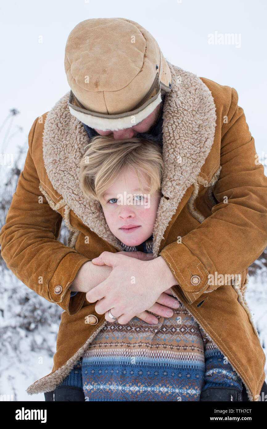 Close up winter portrait of father and son - Stock Image