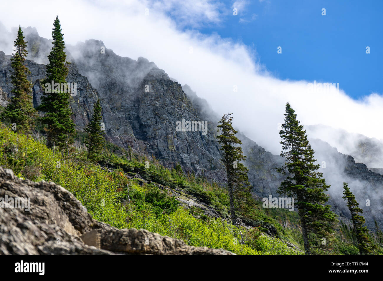 Clouds obscure mountain peak - Stock Image