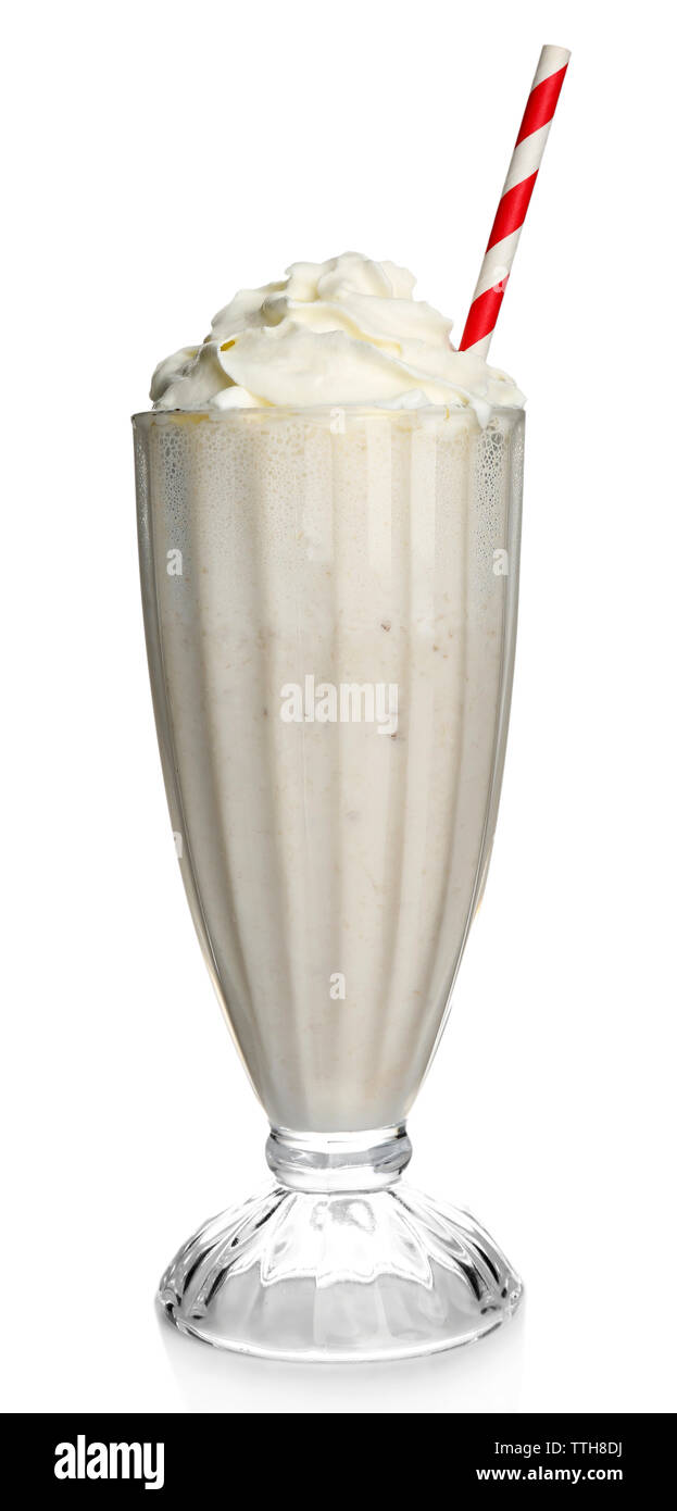 Glass of milk cocktail with cream isolated on white - Stock Image