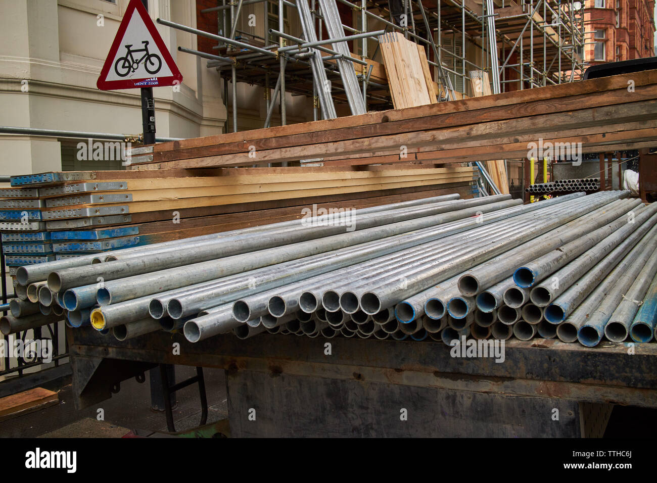 Professional scaffolding rods on the back of a work lorry. - Stock Image