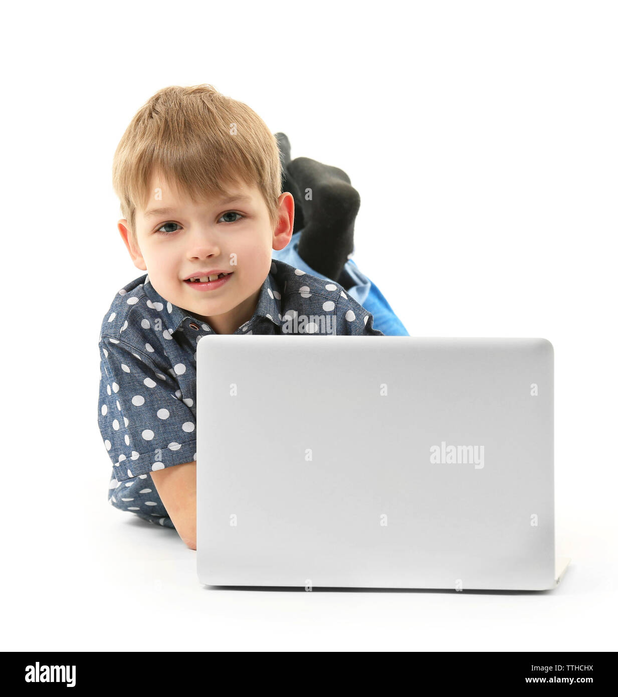 Little boy with laptop isolated on white - Stock Image