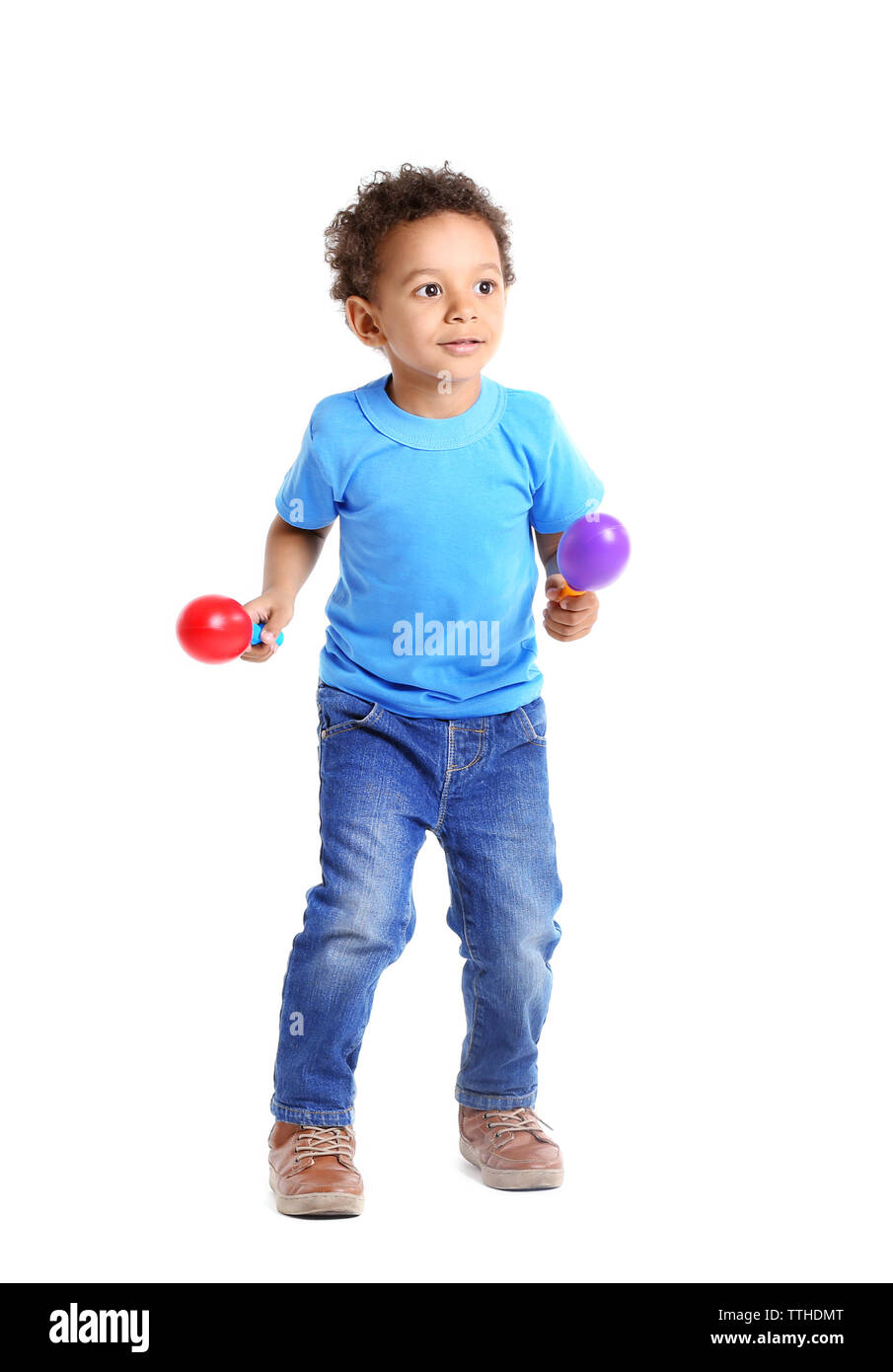 Little boy playing on maracas, isolated on white - Stock Image