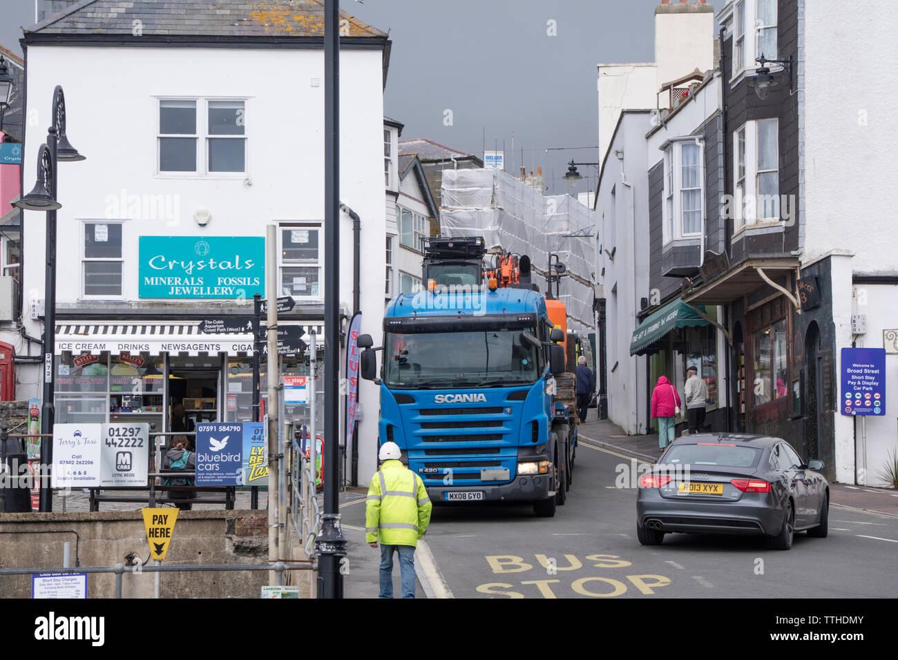 Heavy vehicles in the narrow streets of Lyme Regis, Dorset, England, UK - Stock Image