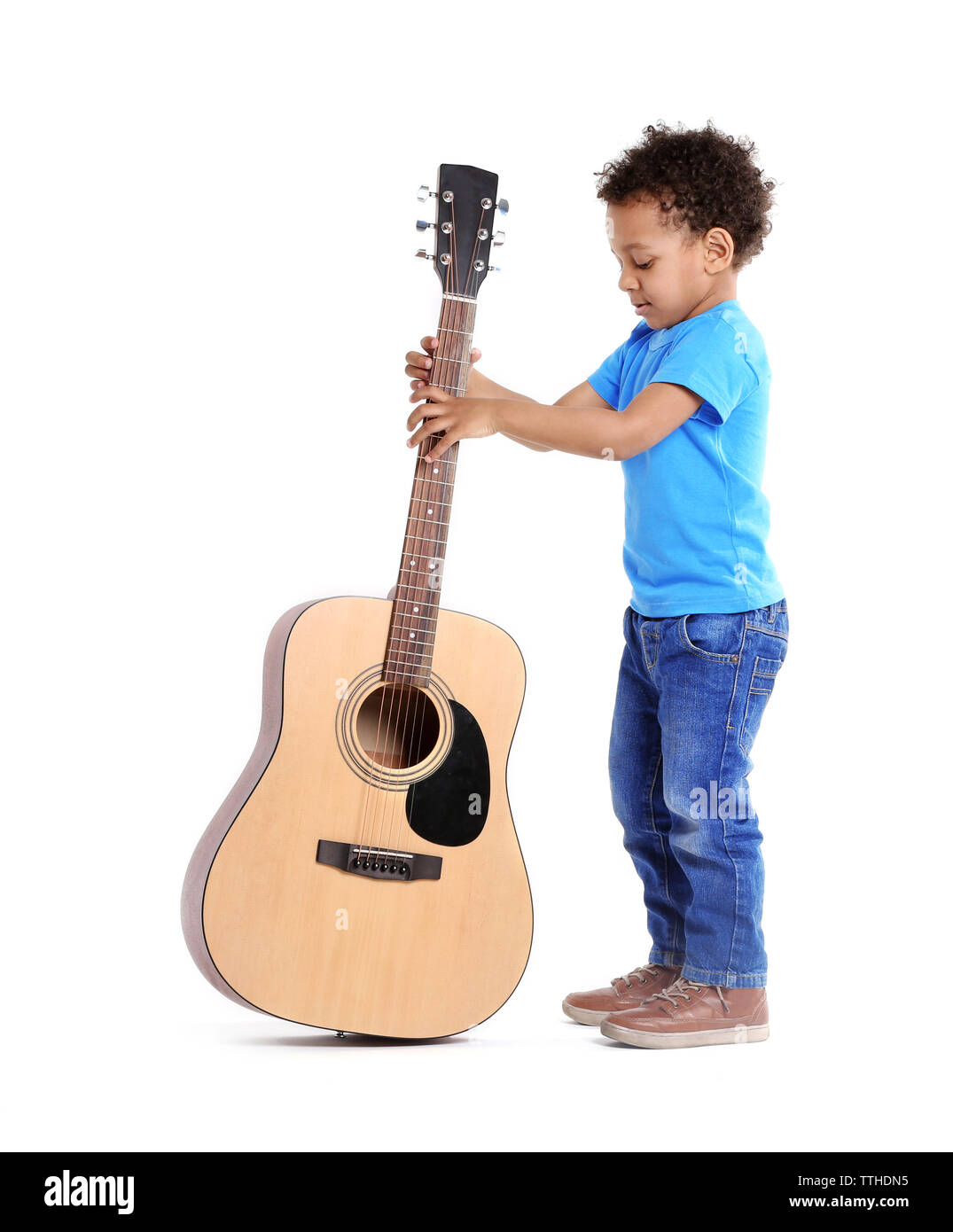 Little boy playing guitar, isolated on white - Stock Image