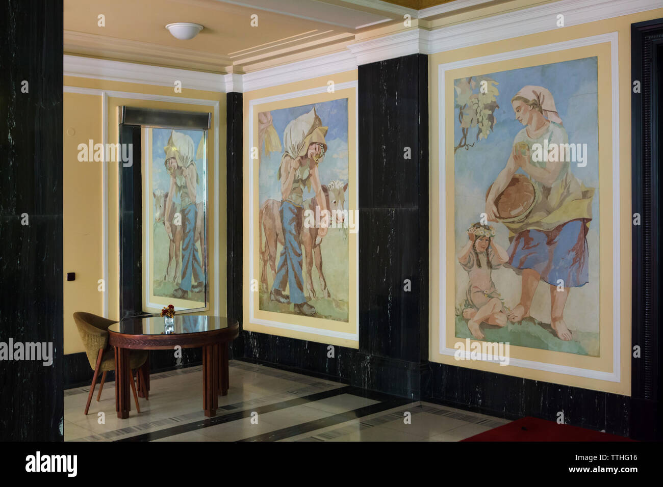Venetian stucco panels by Czech artists Josef Novák and Stanislav Ullman on the main staircase of the in the Hotel International in Dejvice district in Prague, Czech Republic. The hotel inspired by Soviet Stalinist architecture was designed by Czech architect František Jeřábek and built in 1952-1956. Stock Photo