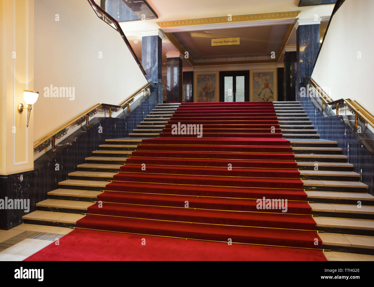 Main staircase in the Hotel International in Dejvice district in Prague, Czech Republic. The hotel inspired by Soviet Stalinist architecture was designed by Czech architect František Jeřábek and built in 1952-1956. The staircase railing was designed and manufactured by Czech artist Jan Nušl. According to the local legend, Czechoslovak army generals should guard on each step of the staircase as a guard of honour when Soviet dictator Joseph Stalin goes up the staircase during his official visit to Czechoslovakia. This is why the staircase has 22 steps, one step for two of 44 Czechoslovak Stock Photo