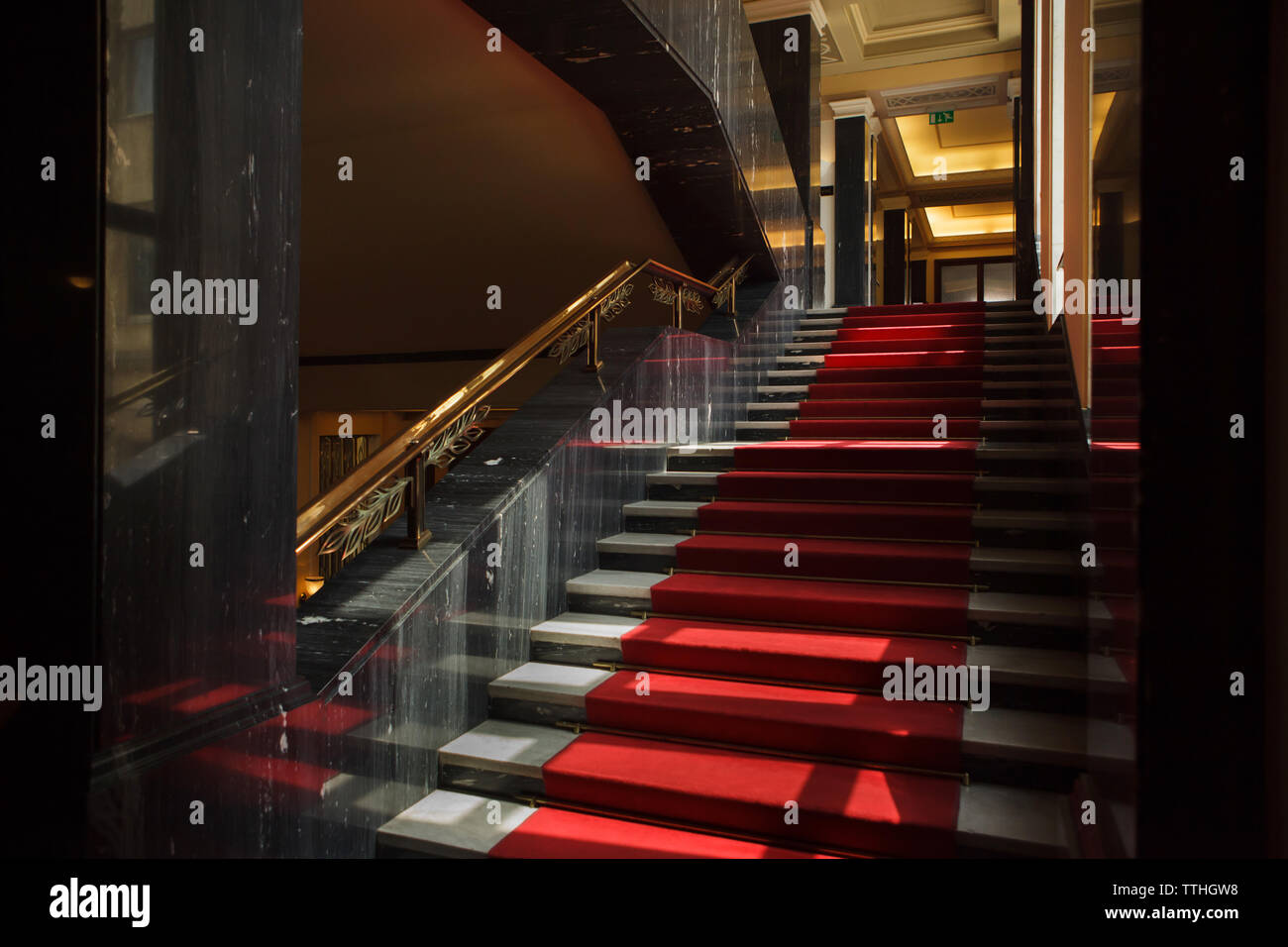 Main staircase in the Hotel International in Dejvice district in Prague, Czech Republic. The hotel inspired by Soviet Stalinist architecture was designed by Czech architect František Jeřábek and built in 1952-1956. The staircase railing was designed and manufactured by Czech artist Jan Nušl. Stock Photo