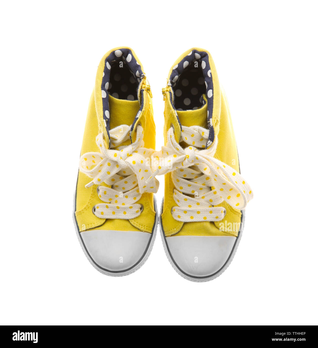 Yellow gumshoes for girls, isolated on white - Stock Image