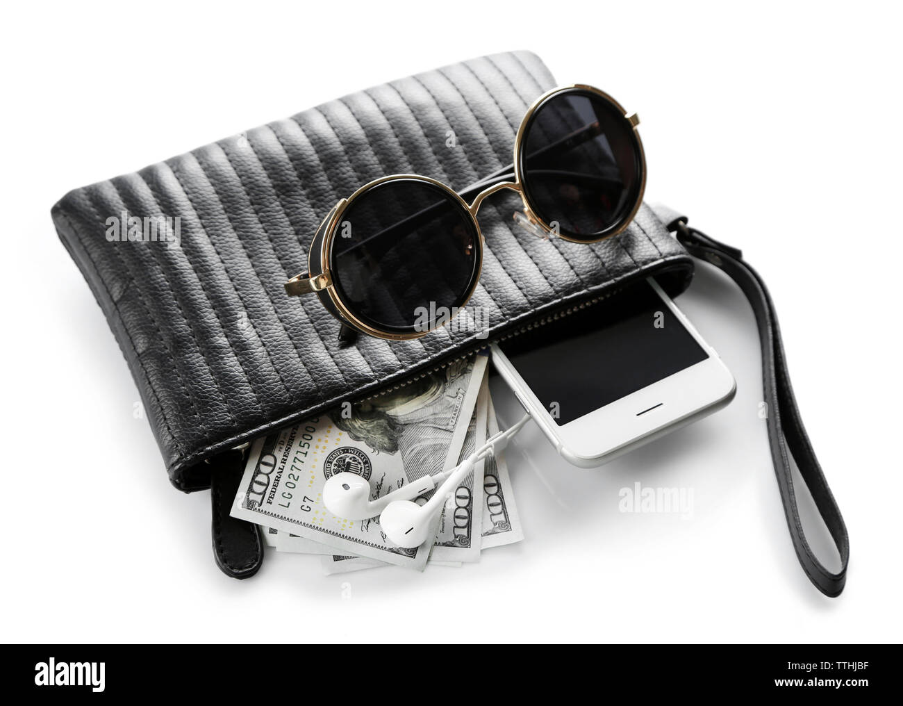 Leather purse with mobile phone, glasses and dollar banknotes, isolated on white - Stock Image