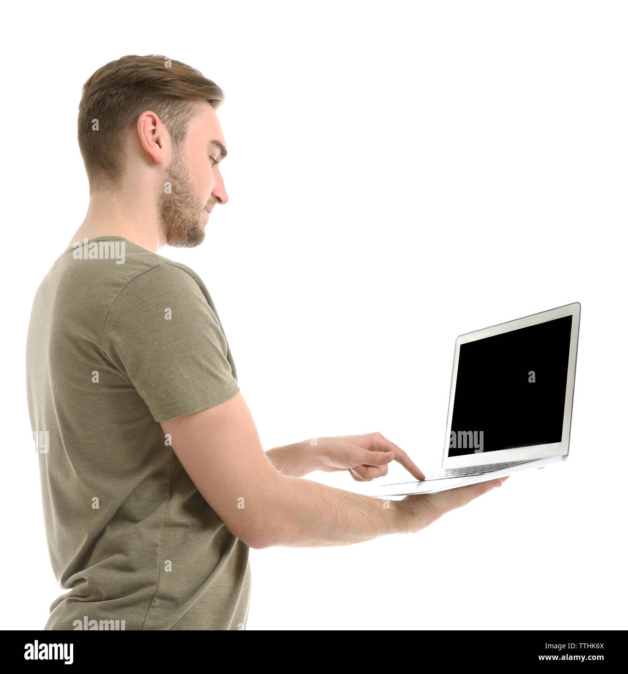 Young man using laptop, isolated on white - Stock Image