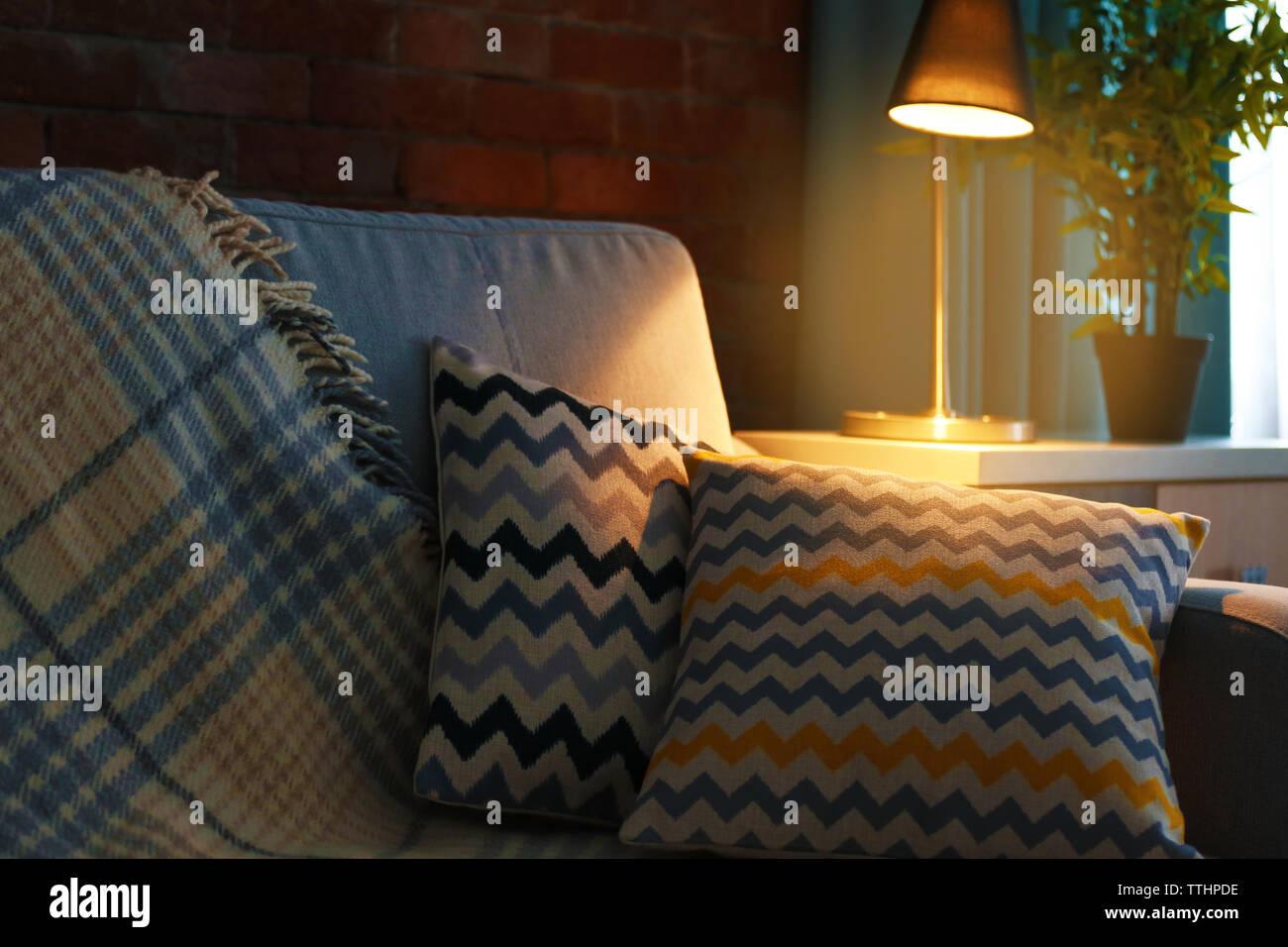 Cushions on sofa, indoors - Stock Image