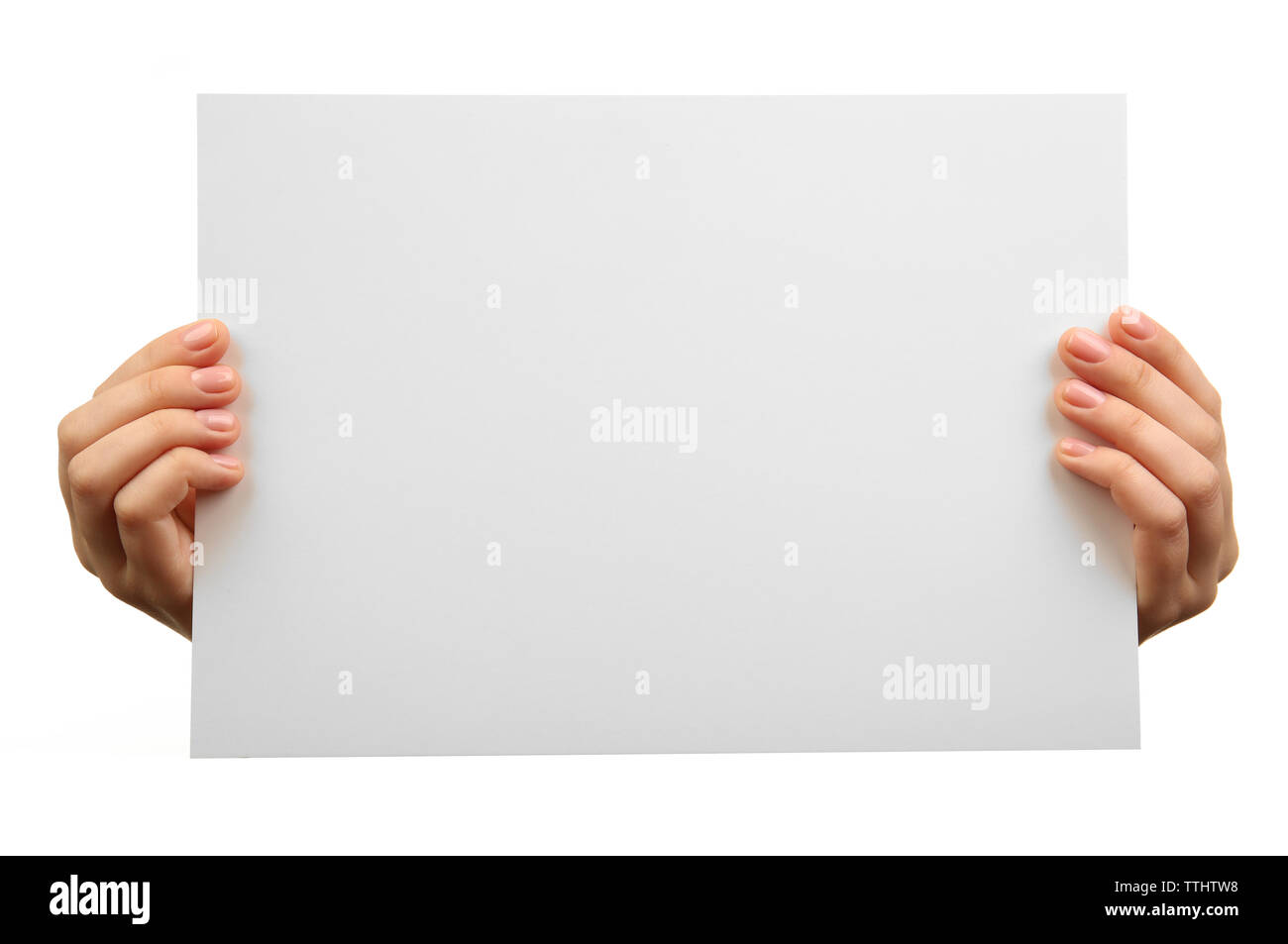 Female hands holding blank sheet of paper isolated on white - Stock Image