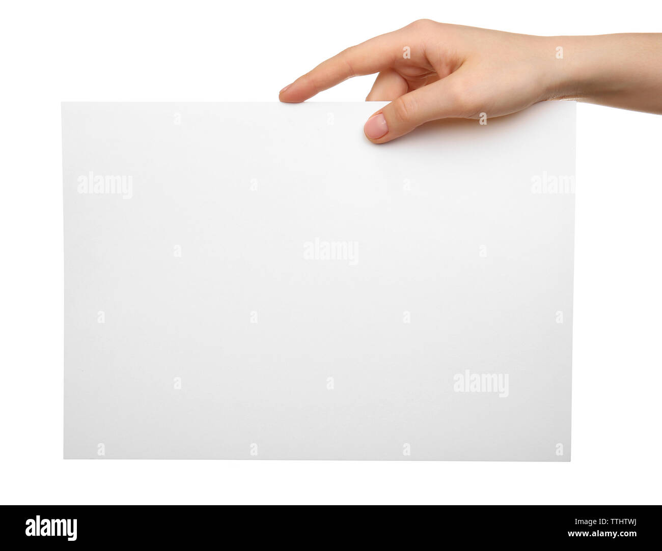 Female hand holding blank sheet of paper isolated on white - Stock Image