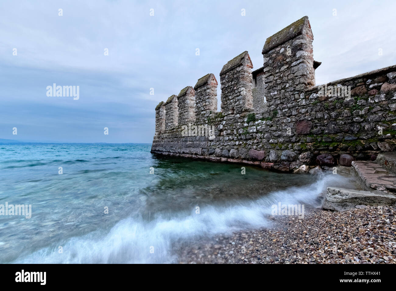 Walls of the Scaligero castle overlook the Lake Garda. Sirmione, Lombardy, Italy, Europe. Stock Photo