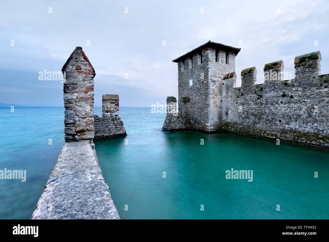 A tower of the Scaligero castle overlook the Lake Garda. Sirmione, Lombardy, Italy, Europe. Stock Photo