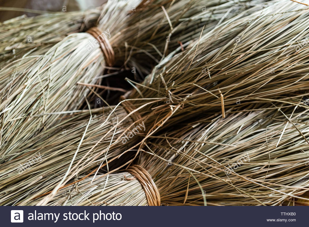 Close-up on sacks of non-dyed straws for sedge mat weaving in the small village of Ben Tre in the Mekong delta region, Vietnam. Horizontal view. - Stock Image