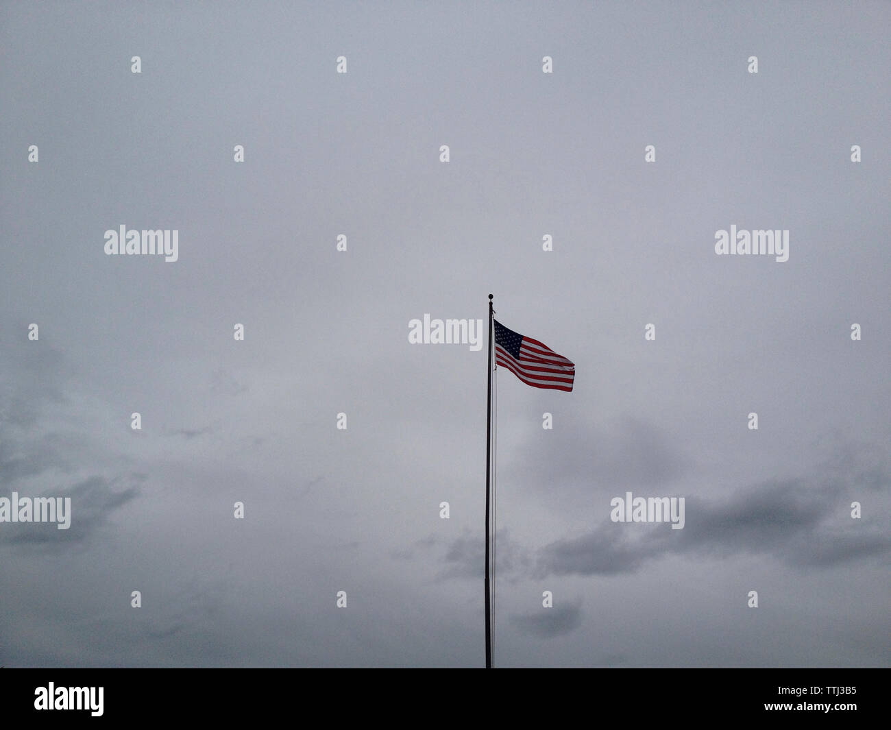 Low angle view of American flag against sky Stock Photo