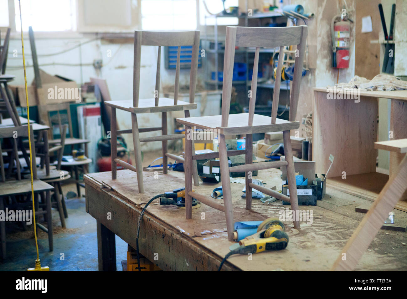 Wooden chairs and work tools at industry Stock Photo